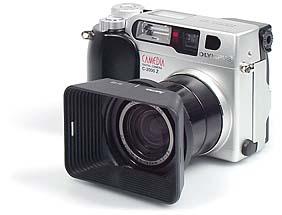 Olympus C-2000 Zoom mit Vorsatzlinsenadapter Olympus CLA-1, Adapterring 43 auf 49 mm und Hama Gegenlichtblende